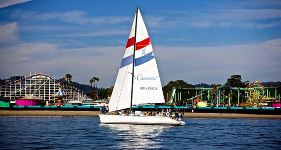 sailboat in front of an amusement park