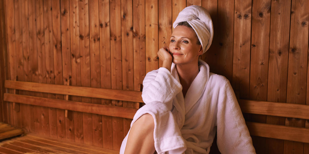 Woman at the spa in a white spa robe