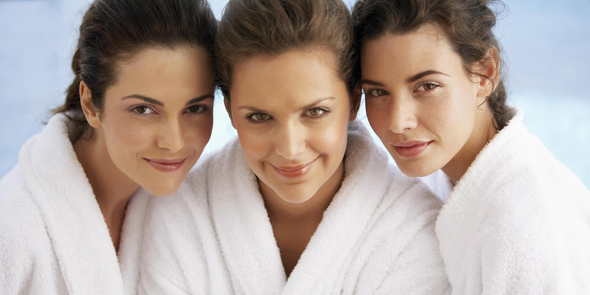 Three woman in spa robes