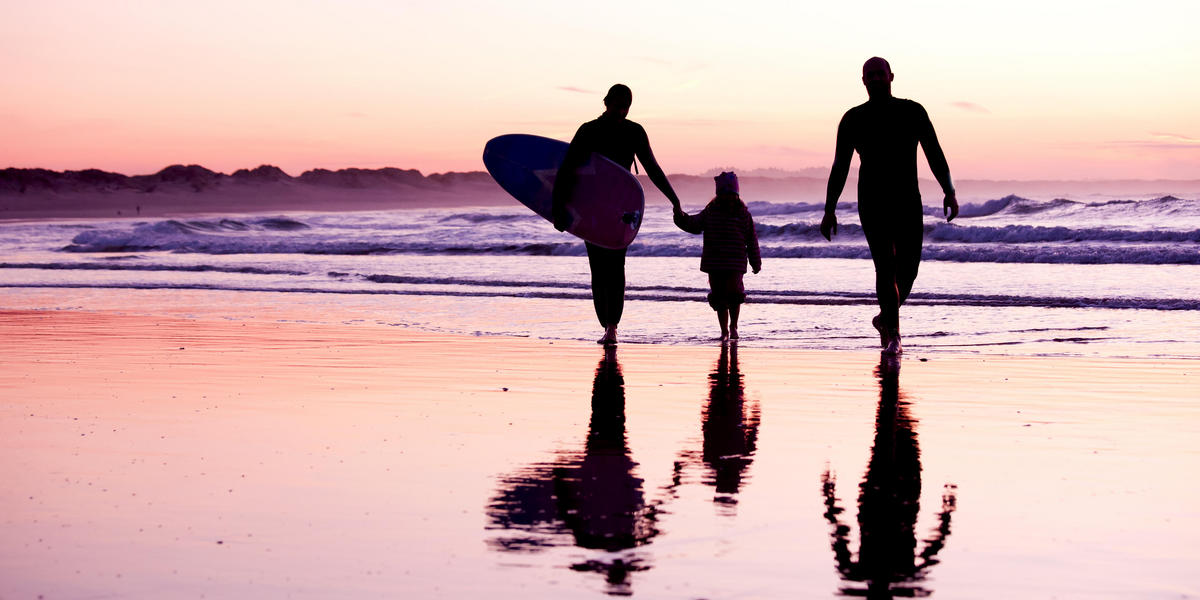 Family on the beach at sunset